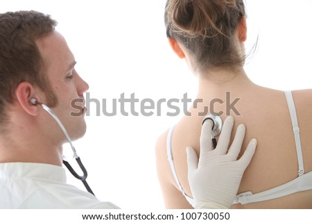 Young male doctor using a stethoscope to listen to his female patient's breathing