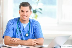 Young male doctor working in clinic
