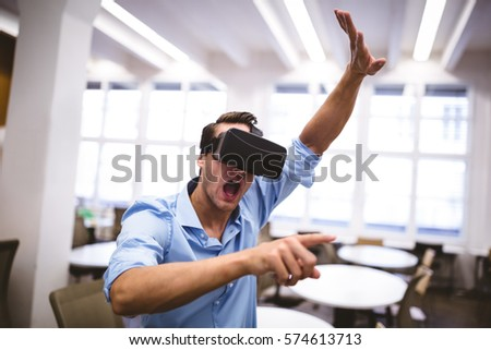 Young male executive enjoying augmented reality headset at office