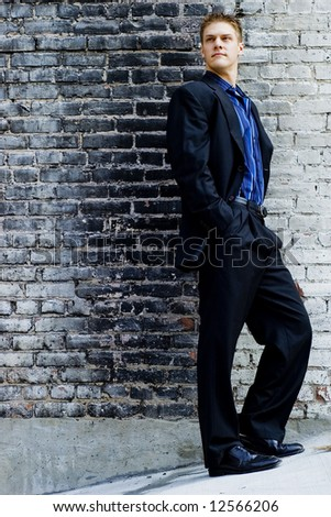 stock photo : Young male fashion model wearing casual business attire