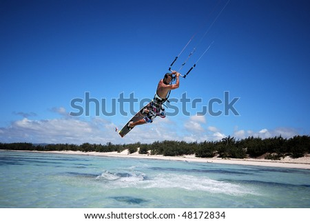 Young male flying over the Indian Ocean