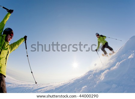Young male freerider skier moving down in snow powder at sunset; italian alps. double exposure