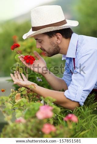 Young male gardener working in the garden #157851581
