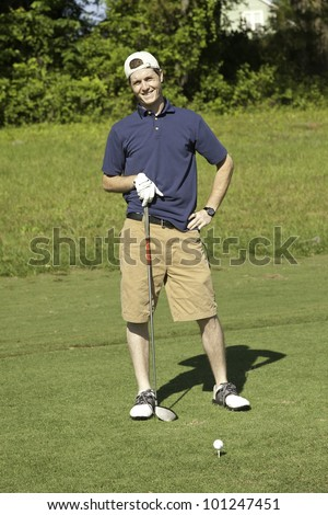 Young male golfer happy with his golf game