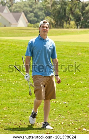 Young male golfer happy with the score of his golf game