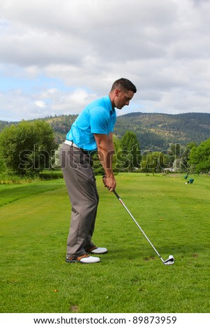Young male golfer ready for his tee shot