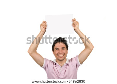 Young male holding a blank page over his head,smiling and looking at you isolated on white background