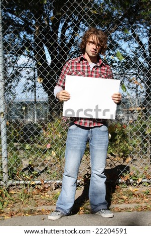 Young male holding a blank sign - just put your own message.