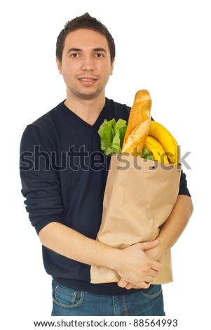 Young male holding shopping bag with groceries isolated on white background