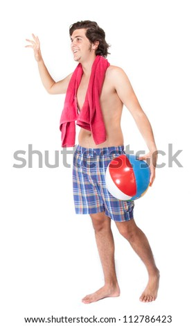 Young male holding towel and beach ball on white background
