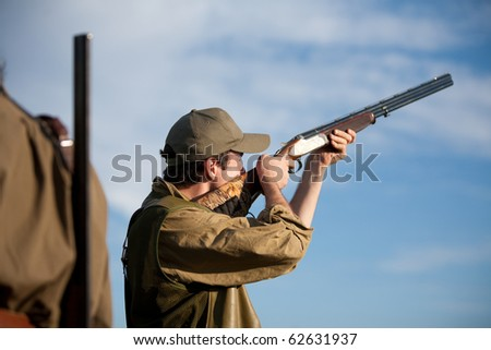 Young male hunter aiming during a hunting party
