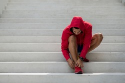 Young male jogger athlete training and doing workout outdoors in city, motion blur