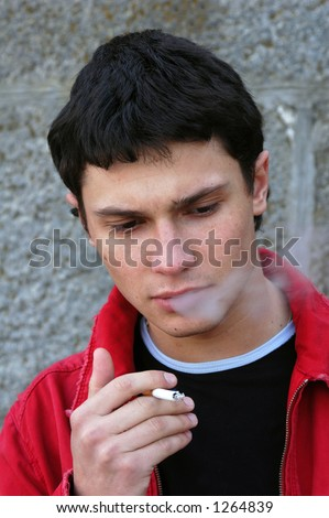 Young male model smoking a cigarette