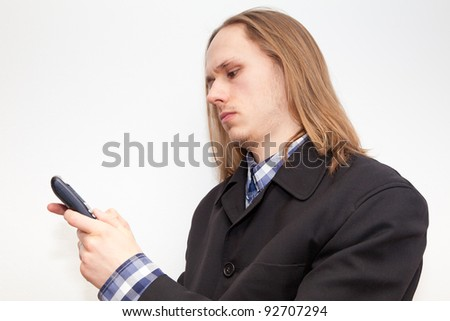 Young male person using cellphone