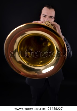 young male playing strait soprano saxophone