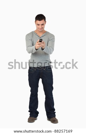 Young male reading text message against a white background