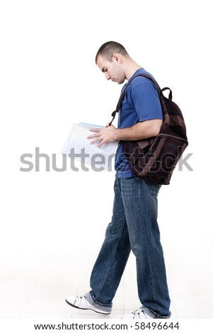 young male student walking to school and studying