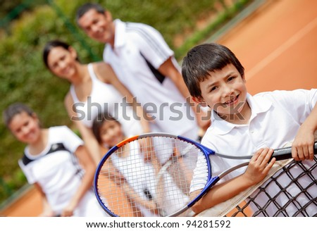Young male tennis player and his family