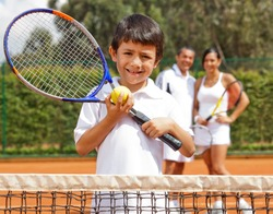 Young male tennis player at a clay court
