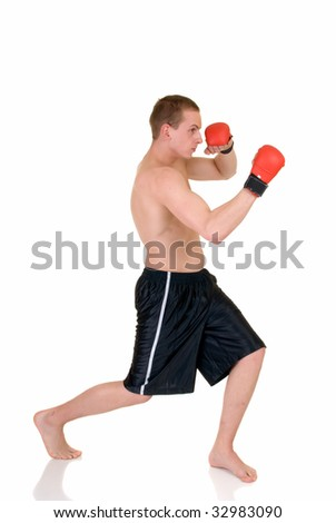 Young male thai boxer, studio shot, intense expression on face, reflective surface,  white background - stock photo
