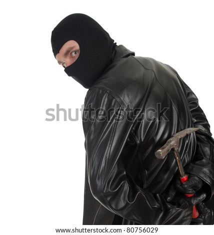 young male thief in balaclava and black leather jacket with hammer