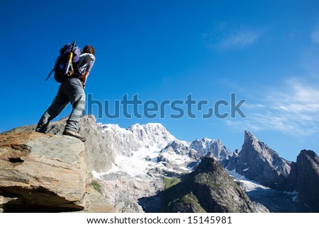 Young male trekker looking at Mont Blanc south face; Mont Blanc, italian side, Courmayeur, Italy.