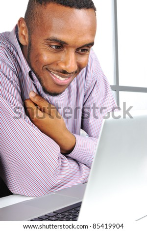 Young man, african american on laptop