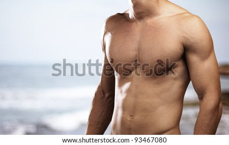 young man against a beach background