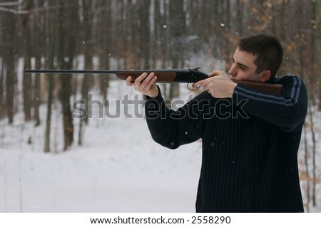 young man aiming shotgun