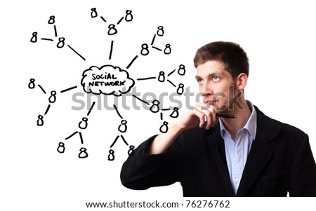 Young man analysing social network schema on the whiteboard