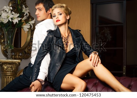 young man and beautiful young woman in beautiful interior. Fashion shoot.