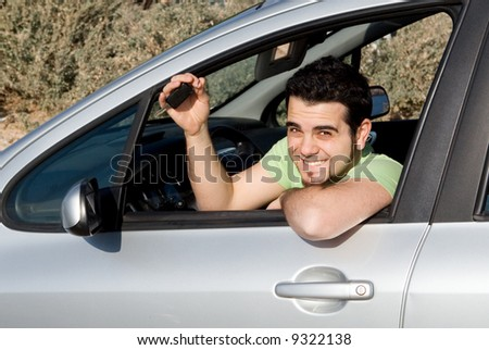 young man and car key