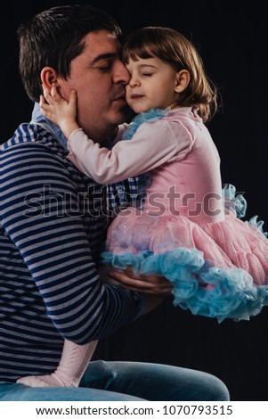 Cute young little girls kissing