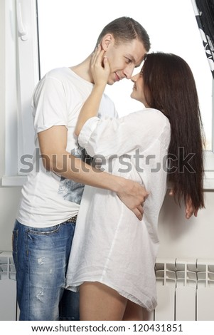 young man and girl look at each other and smiling