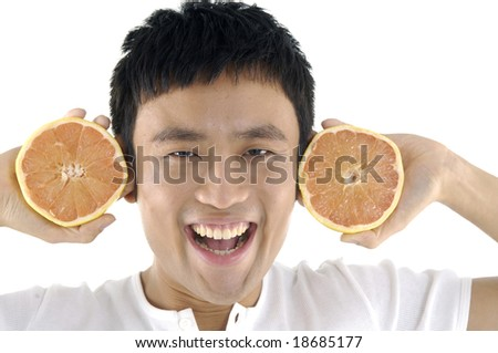 young man and grapefruit over white