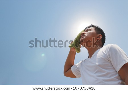 Young man and heat stroke. - Shutterstock ID 1070758418