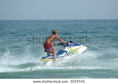 Young man and his jet-ski