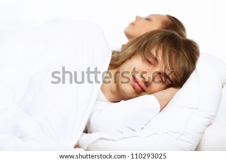 Young man and his wife go to bed