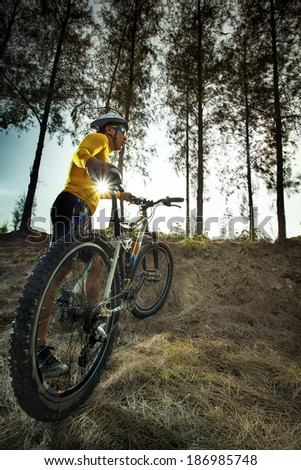 young man and mountain bike on jungle track use for sport activities and extreme hobby