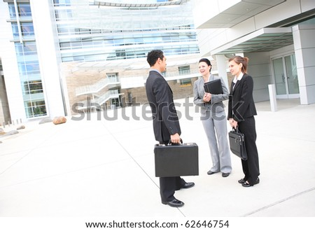 Young man and woman business team at office building