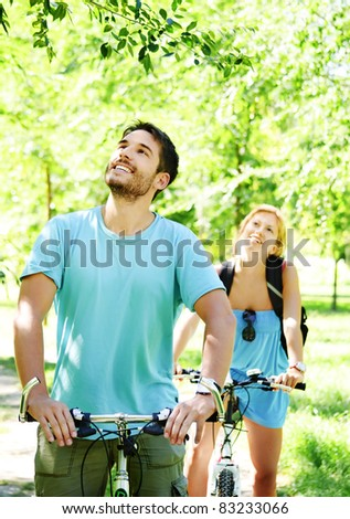 Young man and woman having a bike ride in nature