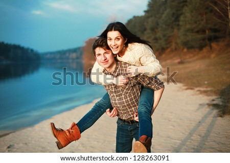 Young man and woman having fun outdoor in spring