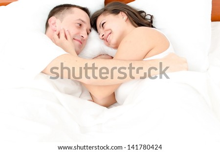 Young man and woman in bed