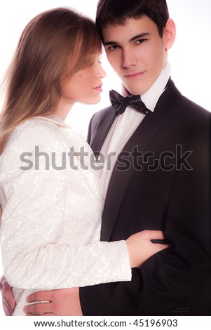 young man and woman in nice clothes on the white background