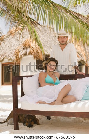 Young man and woman in tropical resort - stock photo