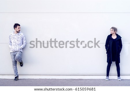 Young man and woman looking at each other from distance