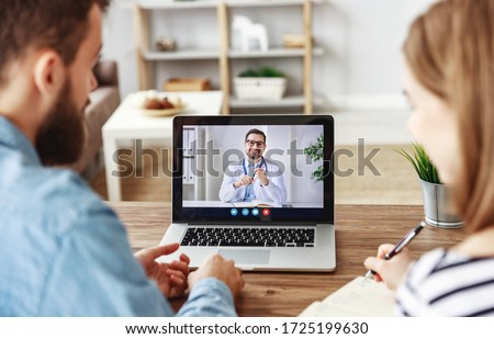 Young man and woman making notes and listening to friendly psychologist while making video call to clinic from home
