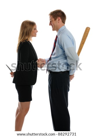 Young Man and Woman shaking hands and hiding weapons isolated on a white background