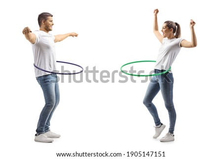 Young man and woman spinning a hula hoops isolated on white background Stock photo ©