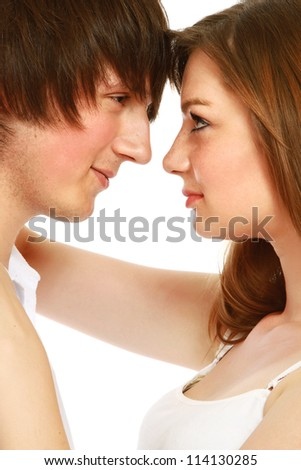Young man and woman together on  white background
